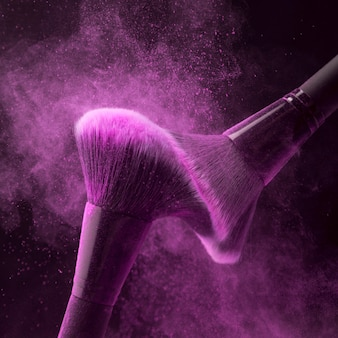 Makeup brushes with fuchsia powder haze