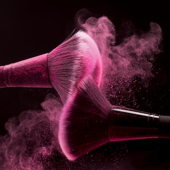 Makeup brushes with pink powder splash