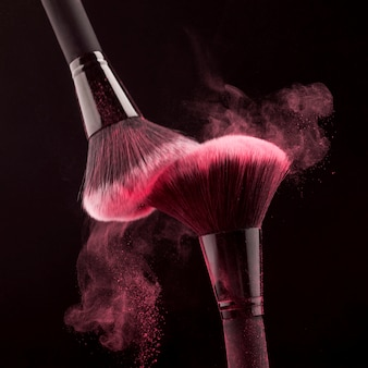 Makeup brushes with whirling pink powder