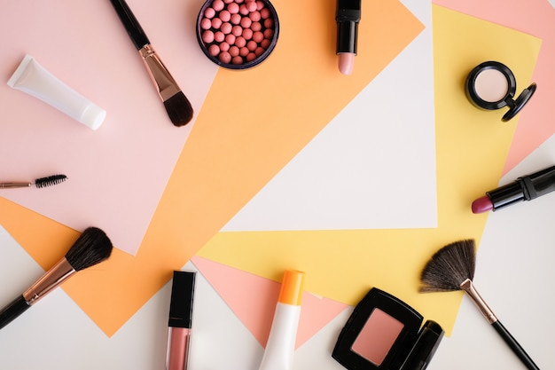 Makeup cosmetic on colour background.