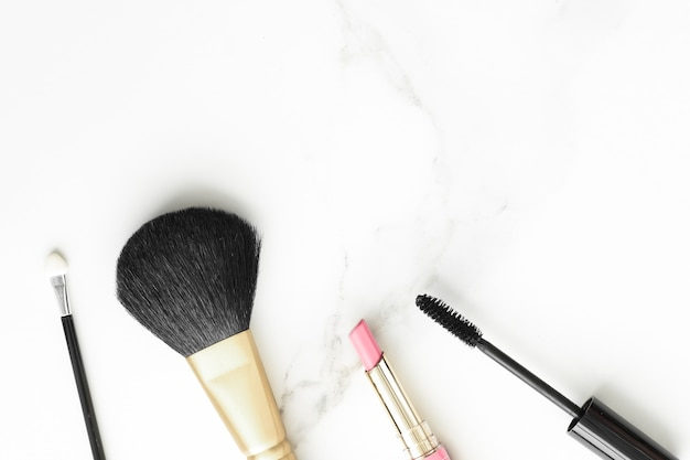 Makeup and cosmetics products on marble flatlay background  modern feminine lifestyle beauty blog and fashion inspiration concept