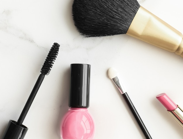 Makeup and cosmetics products on marble flatlay background  modern feminine lifestyle beauty blog an...