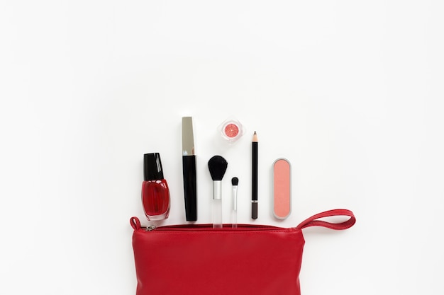 Makeup cosmetics in a red bag