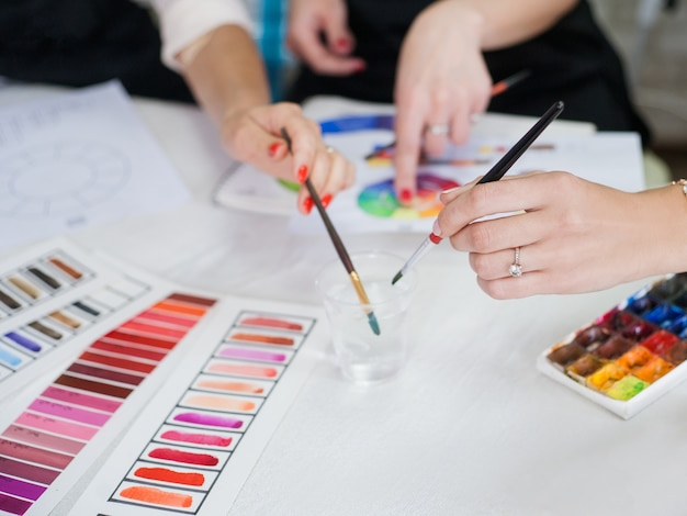 Makeup courses. cropped shot of ladies studying colors, using lipstick palette, paint and brushes.