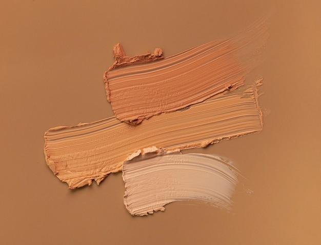 Makeup matte mousse foundation bb cream or concealer smudge creamy powder on beige background