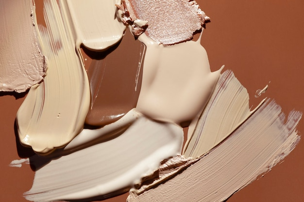 Makeup matte mousse foundation bb cream or concealer smudge creamy powder on brown background