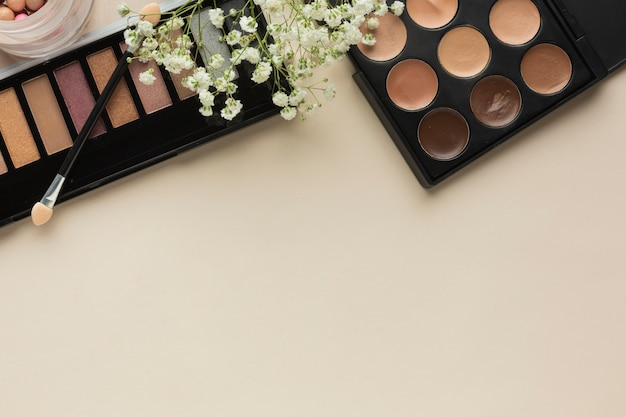 Makeup palettes on table with brush