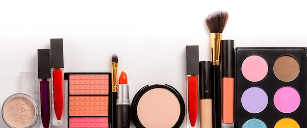 Makeup set, brushes and cosmetics . top view with copy space.