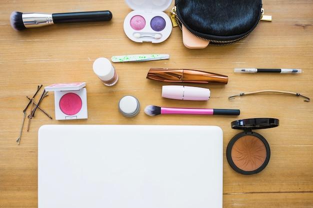 Makeup supplies around laptop