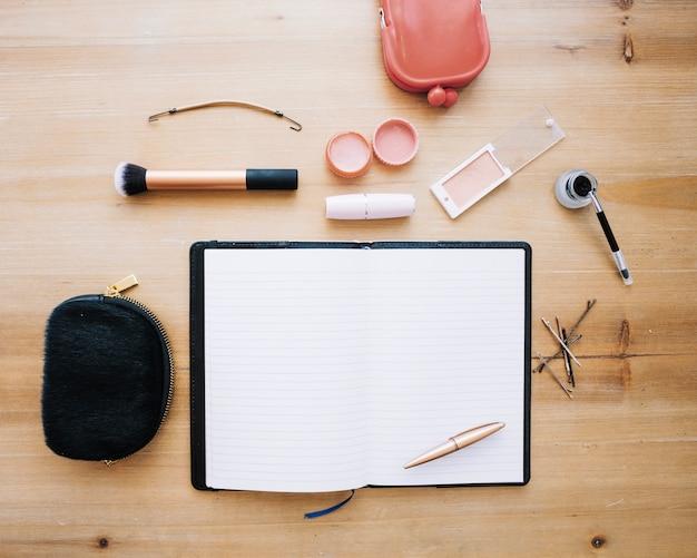 Makeup supplies near notebook