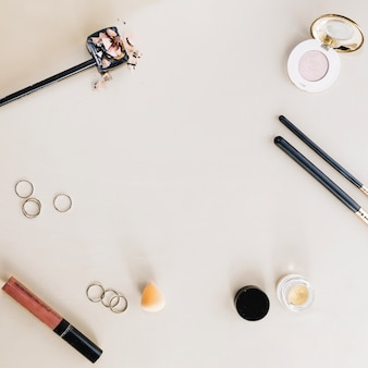 Makeup supplies on white background