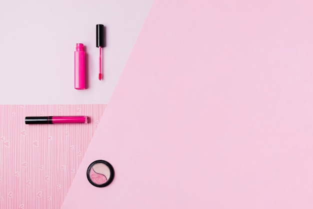 Makeup tools on pink surface