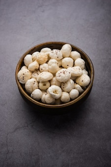 Makhana, also called as lotus seeds or fox nuts are popular dry snacks from india, served in a bowl. selective focus