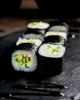 Maki roll with cucumber and sesame seeds
