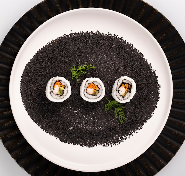 Maki sushi rolls on black sesame seeds