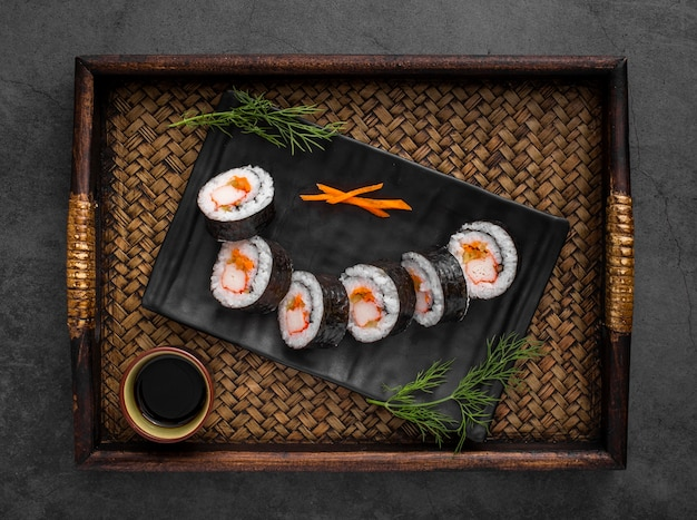 Maki sushi rolls on black slate