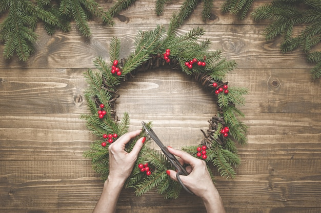 Making christmas wreath using fresh and all natural materials.