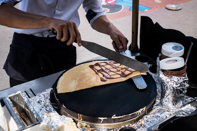 Making crepes on streets of paris