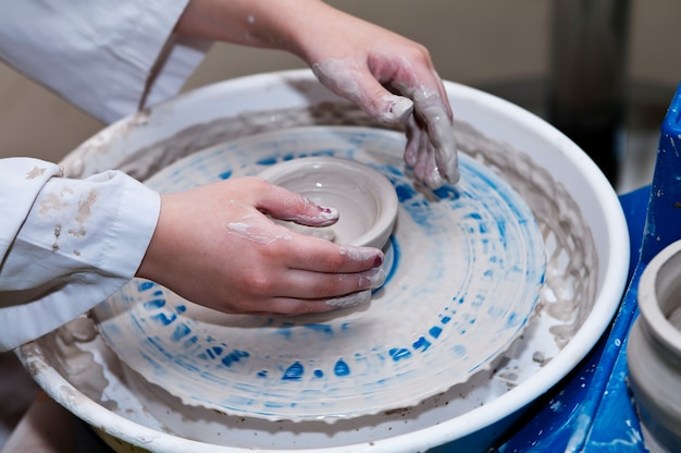 Making dishes on the potter's wheel