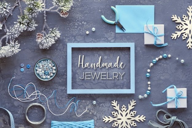 Making handmade jewelry for friends as winter holiday gifts. creative diy craft hobby. flat lay on dark , text