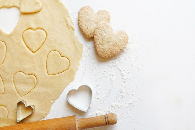 Making homemade heart shaped cookies for valentine day