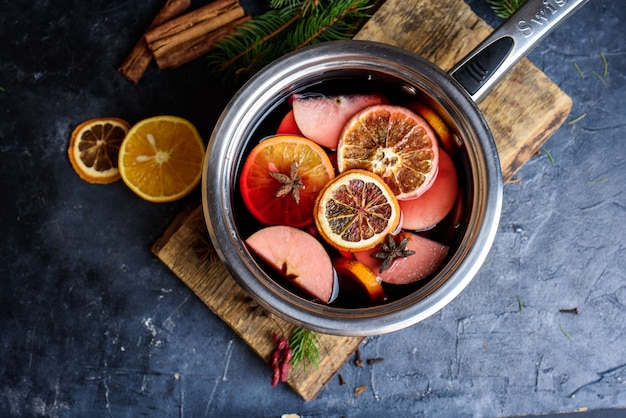 Making hot alcohol, mulled wine for sale at country fair