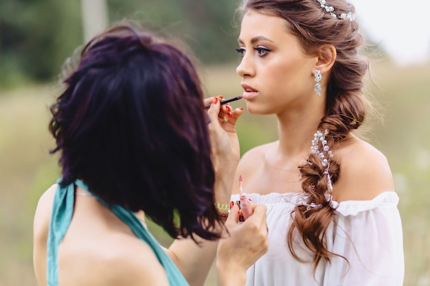 Making makeup in forest fotoshoot