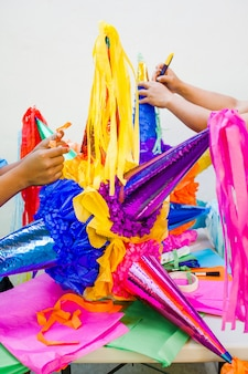 Making a mexican pinata handmade for posadas in christmas in mexico