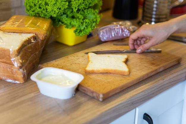 Making morning sandwich at home kitchen copy space