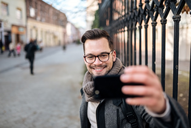 Making a selfie in the city street.