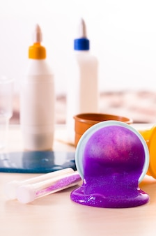 Making slime yourself. ingredients for making bright glittering slime at home.