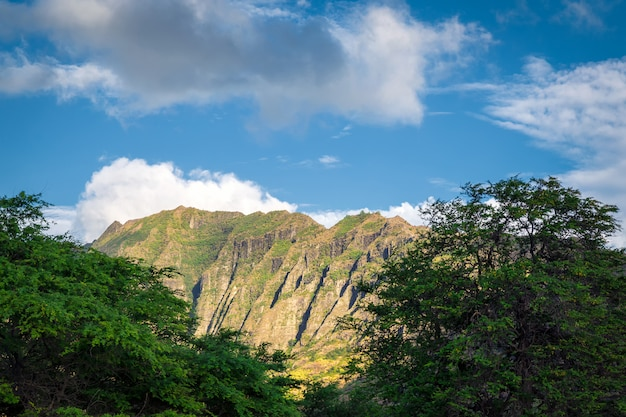 Makua beach view with beatiful mountains and cloudy sky in the background, oahu island, hawaii
