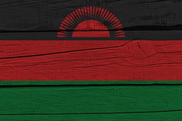 Malawi flag painted on old wood plank