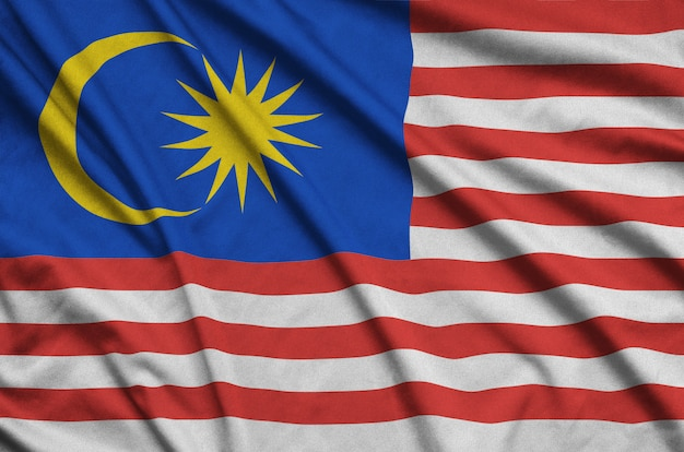 Malaysia flag is depicted on a sports cloth fabric with many folds.