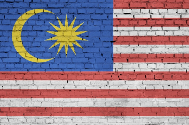 Malaysia flag is painted onto an old brick wall