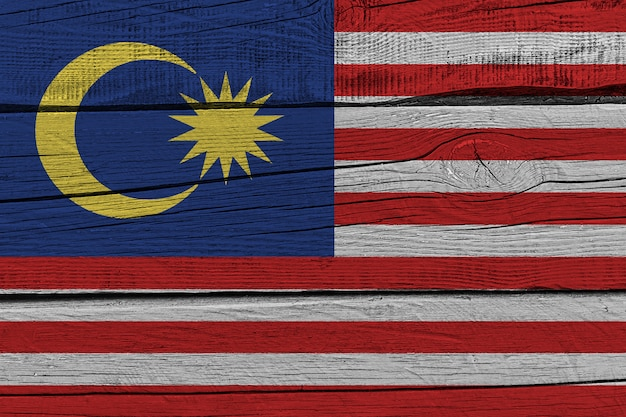 Malaysia flag painted on old wood plank