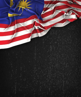 Malaysia flag vintage on a grunge black chalkboard with space for text