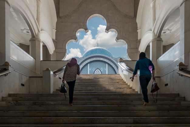 Malaysia mosque with muslim wowen walking at mosque in malaysia, asian