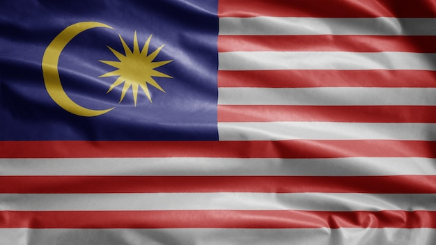 Malaysian flag waving in the wind. malaysia banner blowing, soft and smooth silk