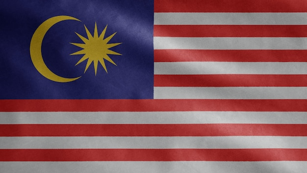 Malaysian flag waving in the wind. malaysia banner blowing, soft and smooth silk.