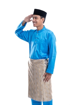 Malaysian man with salute gesture over white background
