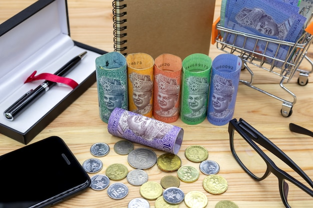 Malaysian ringgit banknotes on wooden table