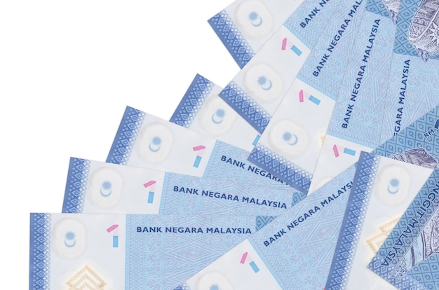 Malaysian ringgit bills lies in different order isolated on white