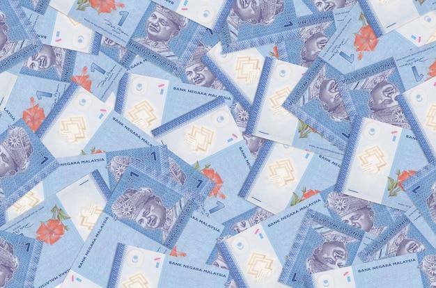 マレーシアリンギットの請求書は大きな山にあります豊かな生活の概念的背景多額のお金