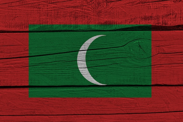 Maldives flag painted on old wood plank