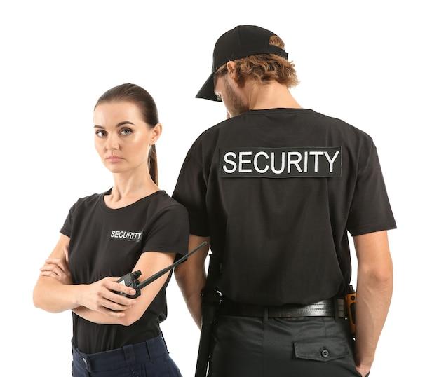 Охранники мужского и женского пола на белом фоне