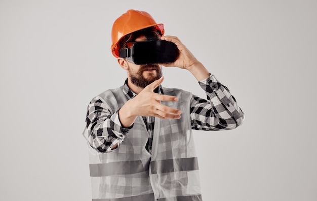 Male architect in orange paint from 3d glasses virtual reality civil engineer. high quality photo