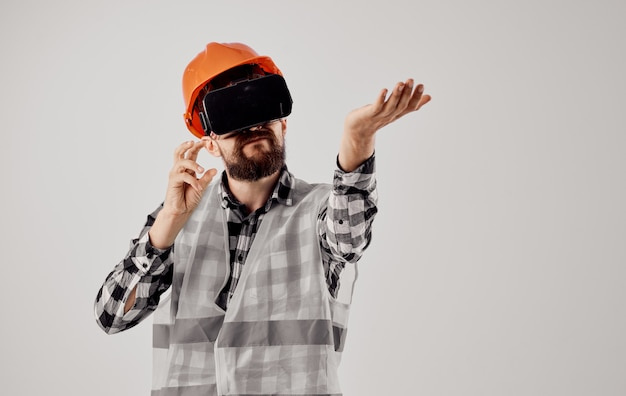 Male architect in orange paint from 3d glasses virtual reality civil engineer