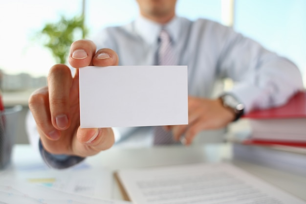 Male arm in suit give blank calling card