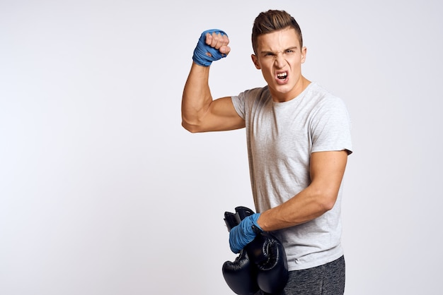 Male athlete boxer is training in the studio
